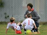 David Beckham on the soccer field with Romeo and Cruz.