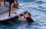 Matt Damon pulled himself onto a boat in St. Barts.