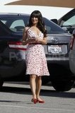 Lea Michele put on a floral-print dress to film Glee.