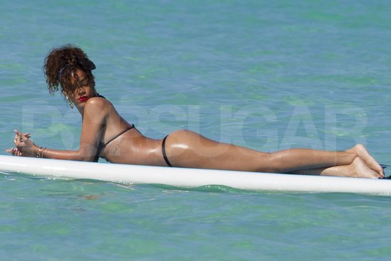 Rihanna was in a string bikini yesterday for an afternoon of surfing in ...