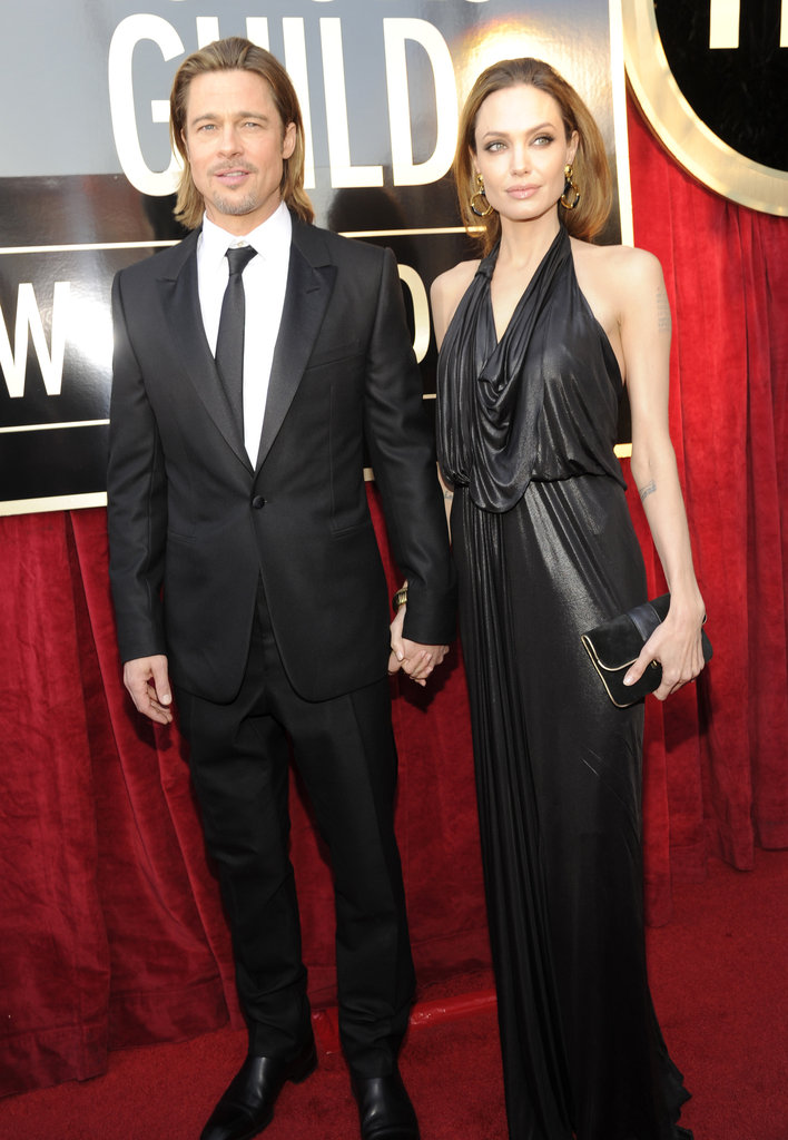 Brad Pitt and Angelina Jolie, in a black Jenny Packham dress, held hands on the red carpet at the 2012 Screen Actors Guild Awards.