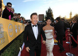 Alec Baldwin and Hilaria Thomas walk the carpet hand-in-hand.