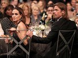 Brad keeps his arm close to Angelina.