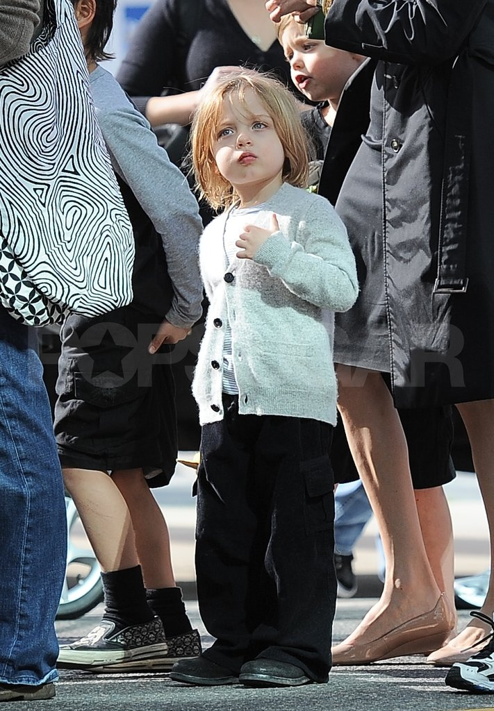 Knox Jolie-Pitt wore a grey sweater.