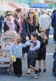 Angelina Jolie held onto Shiloh Jolie-Pitt, while Pax and Knox Jolie-Pitt walked together. Pax wore a tee from Junk Food.