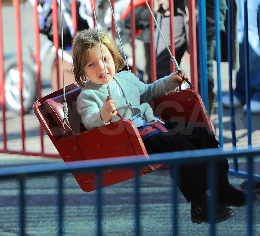 Knox Jolie-Pitt rode the swings.