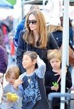Angelina Jolie guided Shiloh Jolie-Pitt, Knox Jolie-Pitt, and Pax Jolie-Pitt through a farmers market.