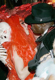 Heidi and boyfriend at the time Seal get close at her annual Halloween party in 2004.