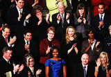 Michelle Obama is joined by a mix of significant Americans, including Laurene Powell Jobs to her upper left.