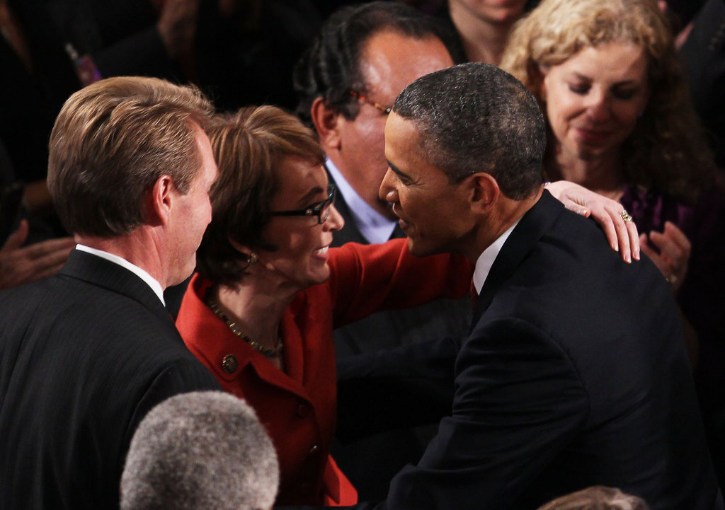 Gabrielle Giffords gives President Obama a hug.