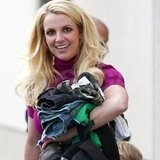 Britney Spears smiled with an armful of her sons' clothes.