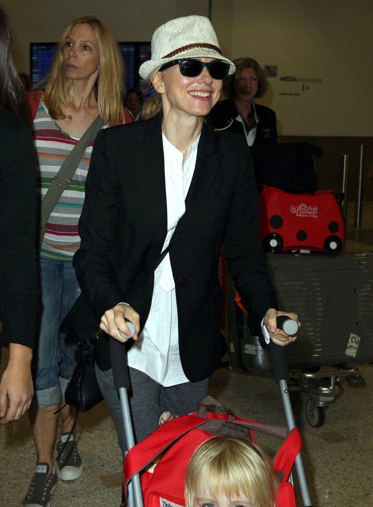 Naomi Watts showed off her airport style in a hat and sunglasses.