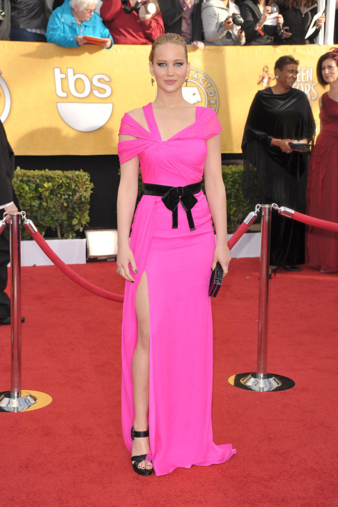The Hunger Games star chose a shocking pink Oscar de la Renta gown walk the 2011 awards' red carpet.
