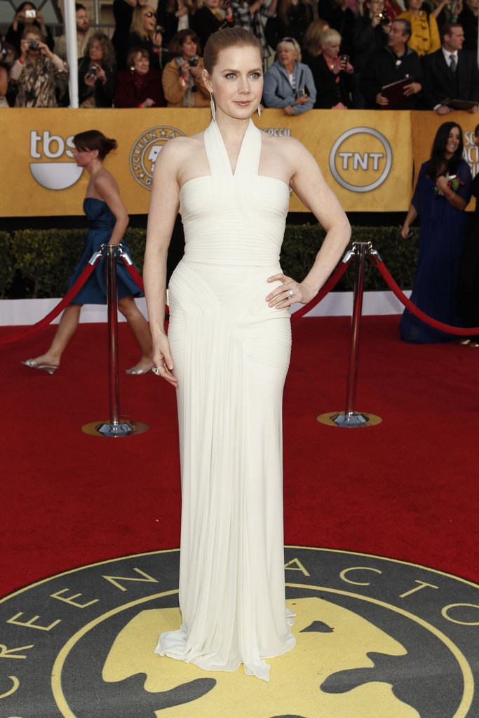 Amy Adams attended the '11 awards in a form-fitting white gown by Hervé Leroux.
