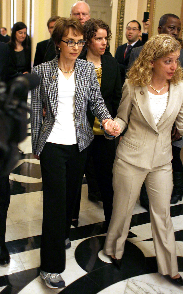 Gabrielle Giffords is escorted down the hall by Rep. Debbie Wasserman Schultz.