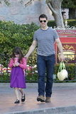 Tom Cruise and Suri Cruise spent a sunny day at Disneyland.