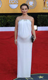 A pregnant Natalie Portman made an entrance in a white, strapless Azzaro gown last year.