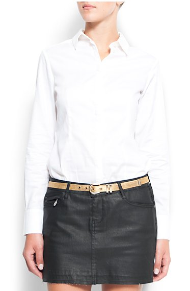 A white buttoned-up shirt is another one of Kate's style staples.   Mango white button-down shirt ($60)