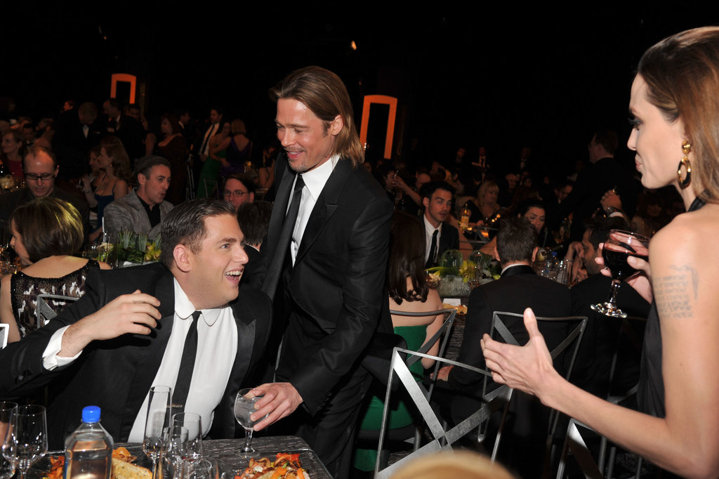 Angelina and Brad were seated with Brad's Moneyball co-star Jonah Hill.