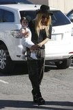 Rachel Zoe carried her 10-month-old son Skyler.