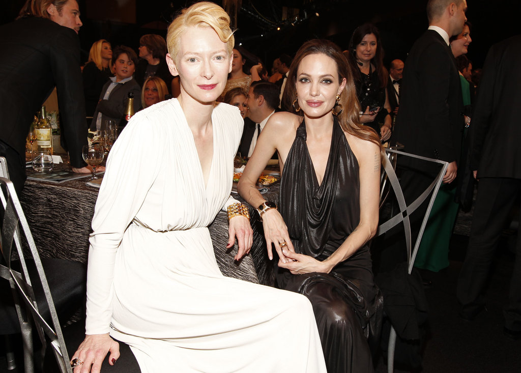 Angelina Jolie and Tilda Swinton sat together.
