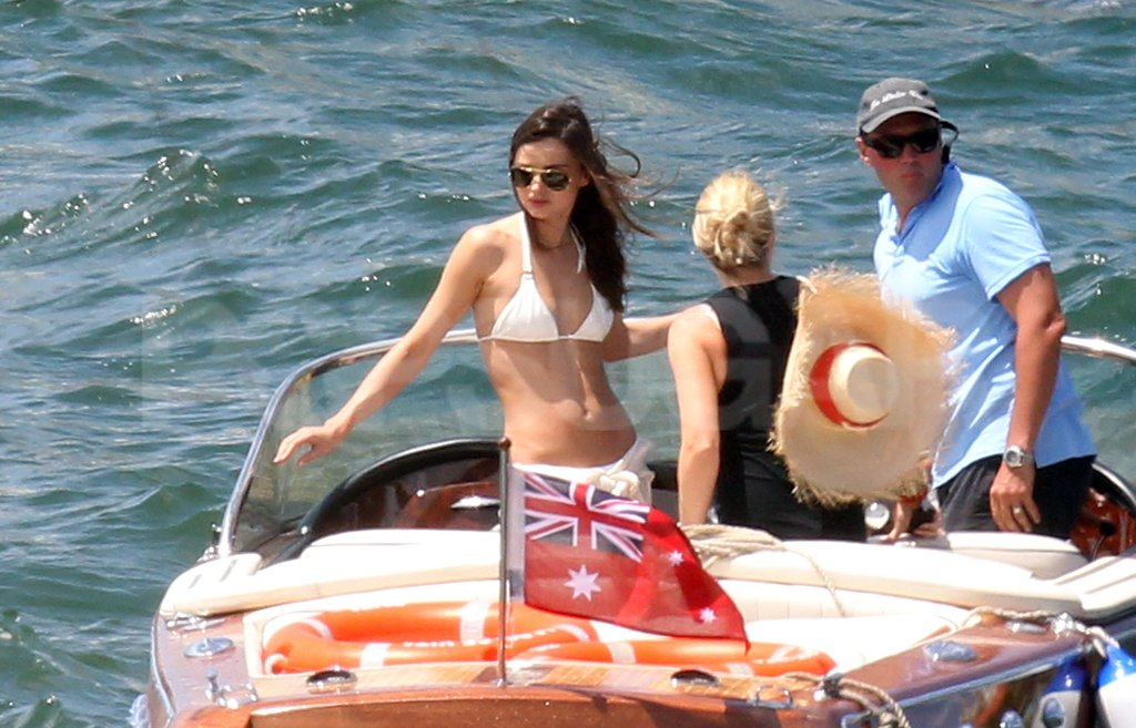 Miranda Kerr hung out on a boat in a white bikini.