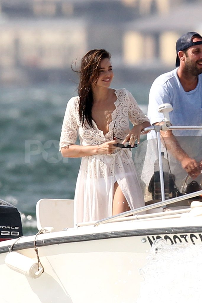 Miranda Kerr had a sheer white dress on over her bikini.