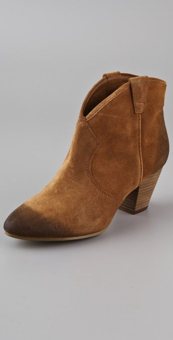 Walkable cute booties that look even better contrasted again slick leather and a mohair sweater. Ash Jalouse Suede Booties ($235)