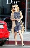 Rachel McAdams shops at Dior.