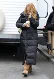 Blake talked on her phone leaving her trailer.