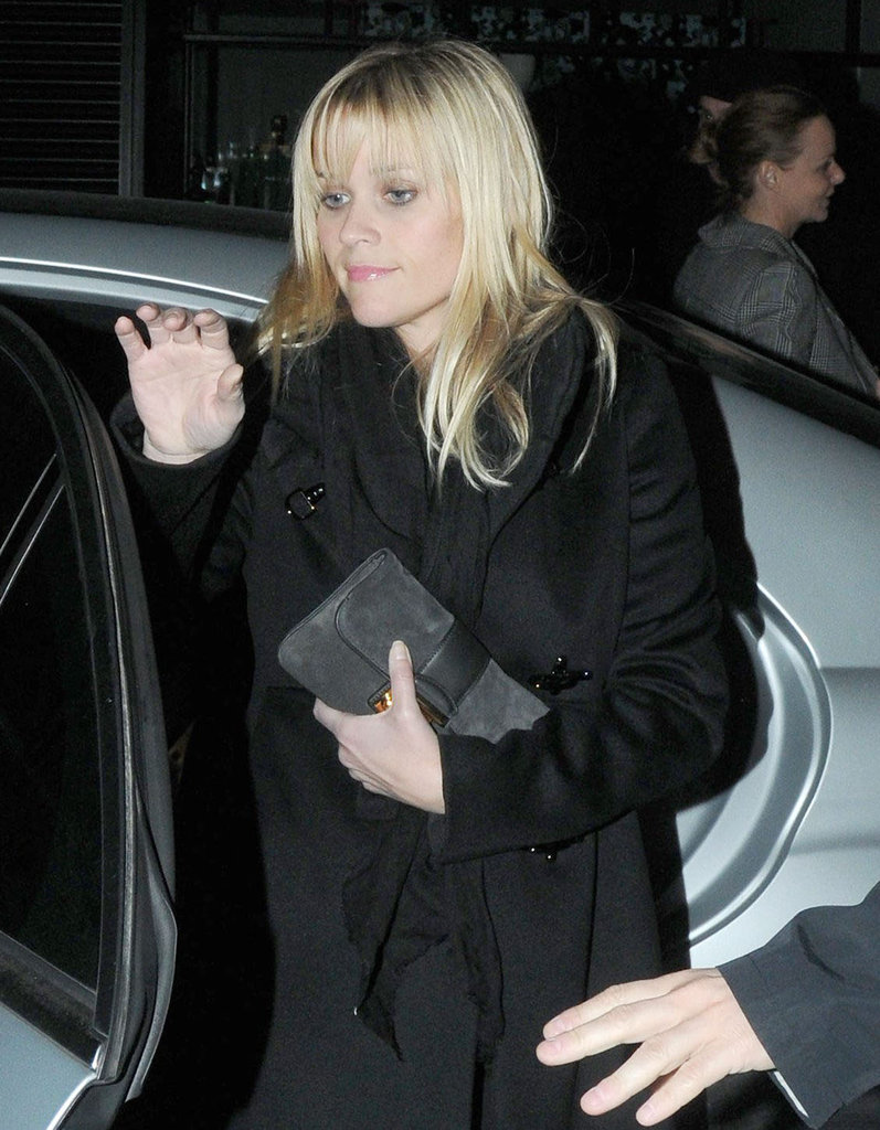 Reese Witherspoon wore her hair straight for a night out in London.