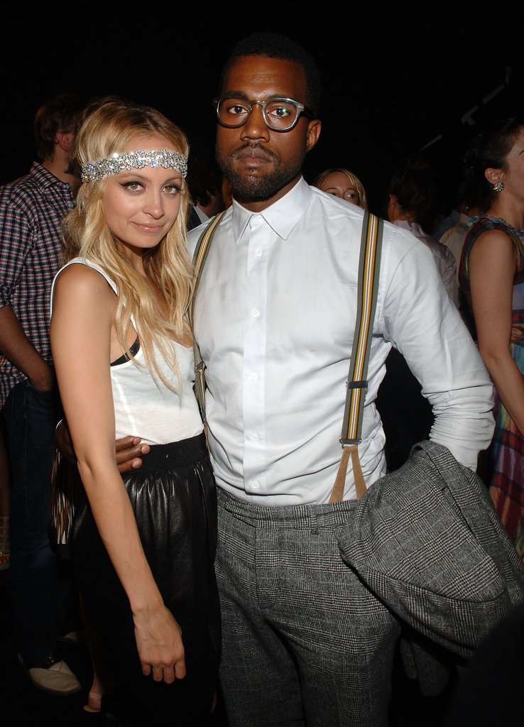 Kanye West, clad in suspenders and geek-chic glasses, posed with Nicole Richie at Marc Jacobs's September 2008 show.