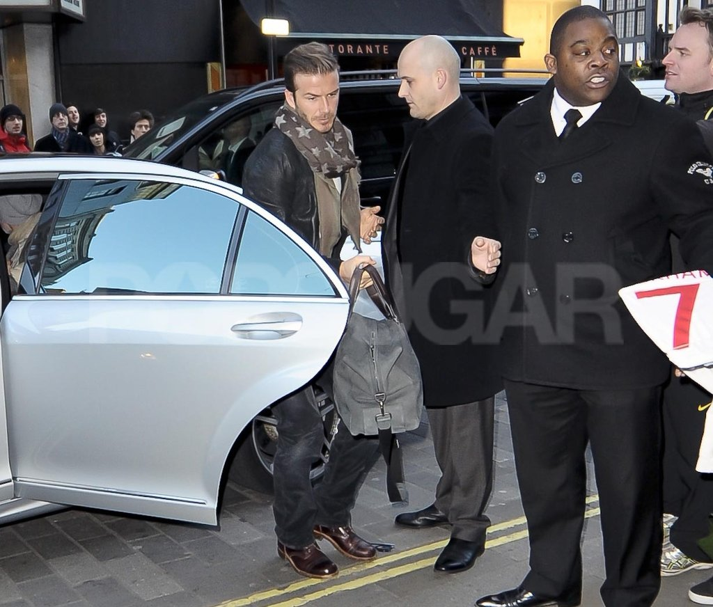 David Beckham got out of a car in London.
