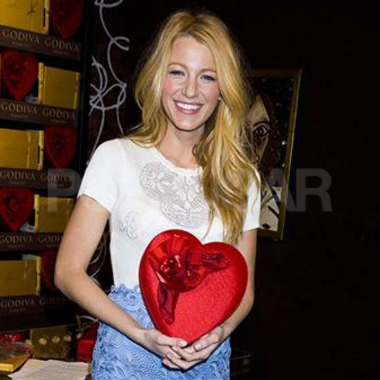 Blake Lively held a box of Godiva chocolates.