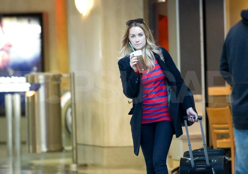 Lauren Conrad headed out of LAX in stripes.
