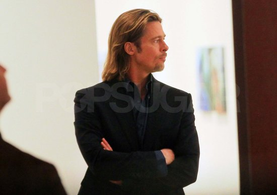 Brad Pitt looking at art.