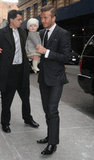 David Beckham coordinated with tiny Harper while arriving at Victoria Beckham's February 2012 NYC Fall Fashion Week presentation.