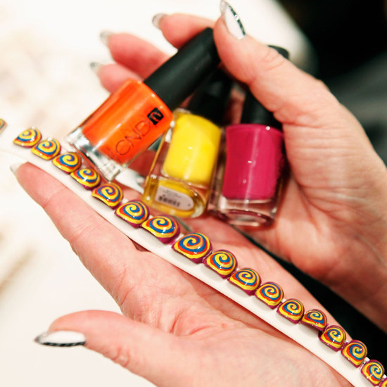 "The nail look featured a palette of four shades from CND (Anchor Blue,  Electric Orange, Bicycle Yellow, and Plumville), creating a  ""past-in-the-present-mood,"" explained the brand's Wanda Ruiz."