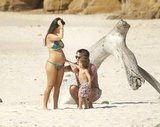 Kourtney, Scott, and Mason took a walk on the beach in Mexico.