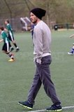 David Beckham went casual for his visit to the soccer field.