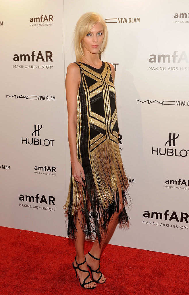 Anja Rubik channeled a glamorous flapper vibe in gold-and-black Gucci.
