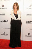 Carine Roitfeld topped her black gown with a white button-down.