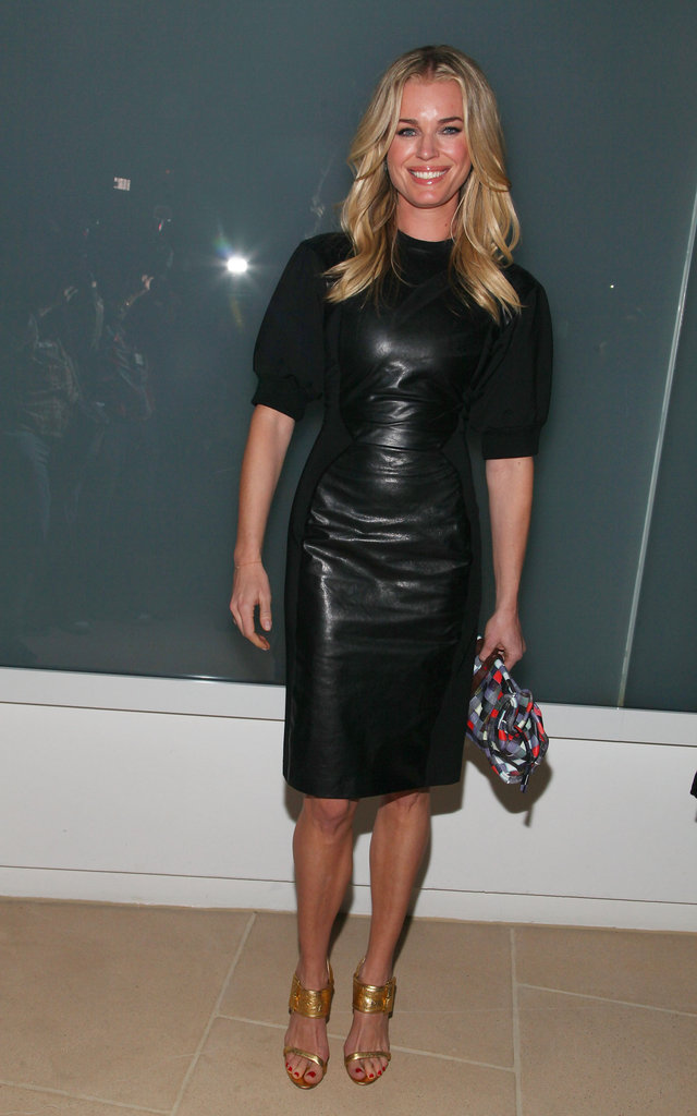 Rebecca Romijn played it ultra-slick in a leather sheath at Cynthia Rowley.