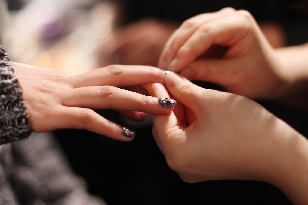 A model gets a colorful addition to her nails. Photo: Roger Kisby