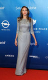 Angelina Jolie chose a long, gray gown with a belted waist for her Cinema for Peace appearance.