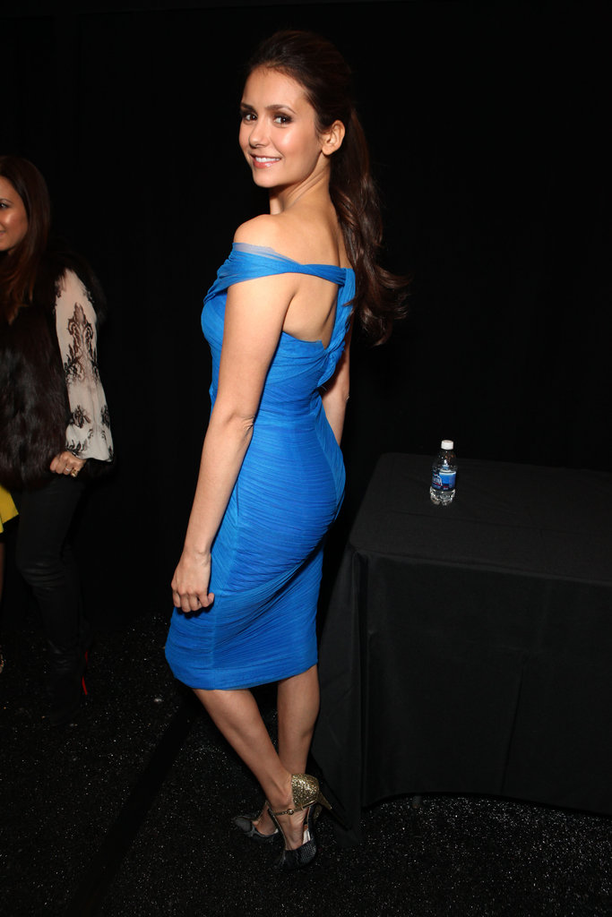 Nina Dobrev revealed the sexy cutouts on her bold dress at Monique Lhuillier.