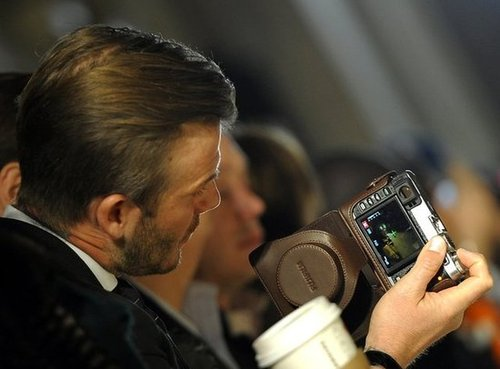 David Beckham snapped photos.