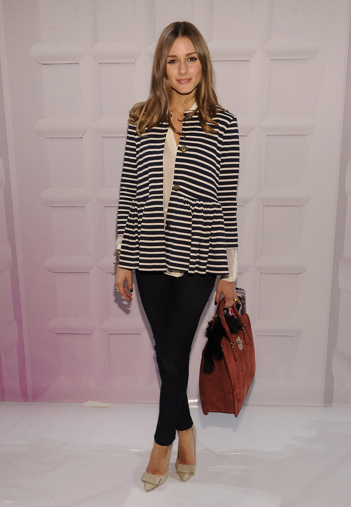 Olivia paired a striped Tibi peplum blazer with denim jeans and polished Mulberry pumps at the Tibi runway show.