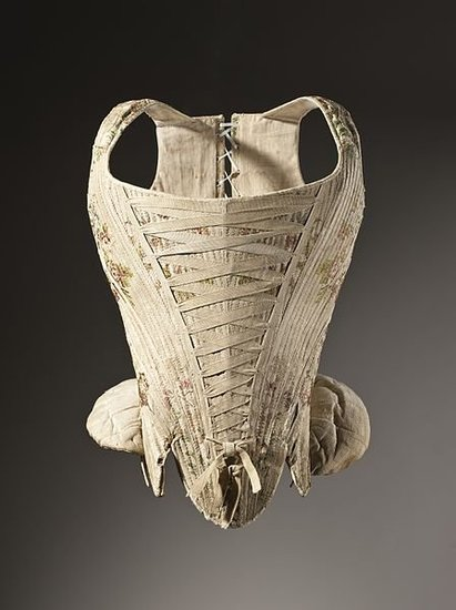 Corsets originated in the 16th to 17th century, but their original form was more of a cone shape that flattened the bodice and pushed the breasts to the top. The emphasis wasn't on the waist, it was on the cleavage.