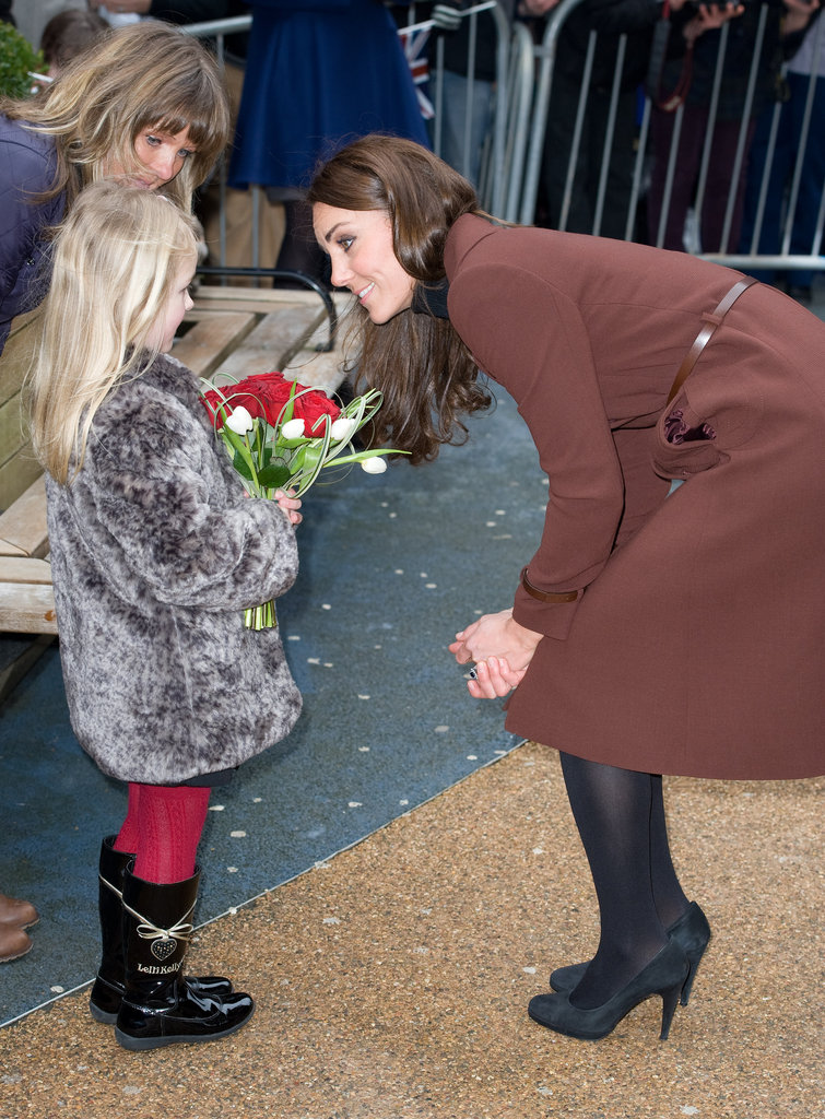 Kate Middleton accepted flowers.